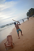 Young men playing cricket on Hikkaduwa beach, Sri Lanka