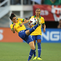 Brazil midfielder Bia (15) kicks the ball during a women's soccer International friendly match between Brazil and the United States National Team, at the Florida Citrus Bowl  on Sunday, November 10, 2013 in Orlando, Florida. The U.S won the game by a score of 4-1.  (AP Photo/Alex Menendez)