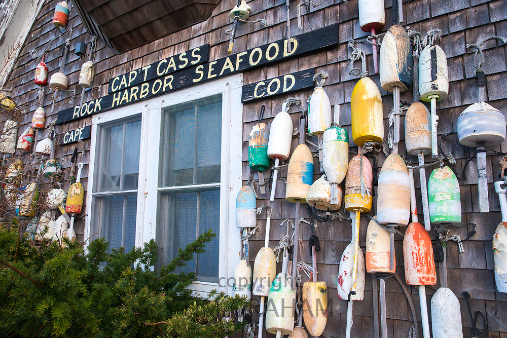 Oak shingles and colourful lobster buoys at Captain Cass - Cap't Cass Rock Harbor Seafood Cafe at Orleans, Cape Cod, New England, USA