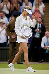 LONDON, ENGLAND - Saturday, July 5, 2014: Eugenie Bouchard (CAN) with the runners-up shield after losing the Ladies' Singles Final match on day twelve of the Wimbledon Lawn Tennis Championships at the All England Lawn Tennis and Croquet Club. (Pic by David Rawcliffe/Propaganda)