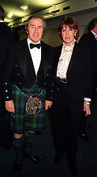 MR & MRS JACKIE STEWART he is the former world champion racing driver, at a dinner in London on 25th January 2000.OAI 4