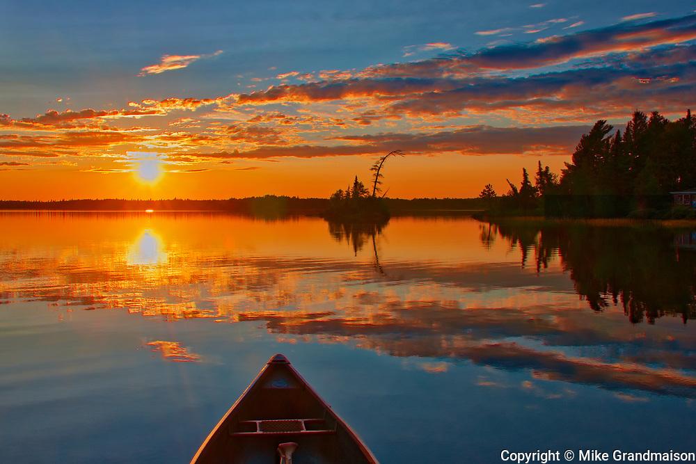 Boat and sunset on Lac des Sables<br />Belleterre<br />Quebec<br />Canada