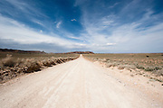 A desert road in southern Utah in the San Rafael Swell Area. Missoula Photographer