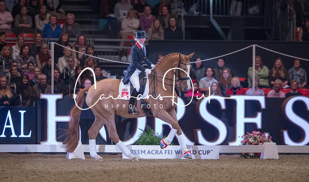 Laura Tomlinson (GBR) retires Mistral Hojris (Alf) at the London International Horse Show Olympia<br /> Reem Acra FEI World Cup Dressage K&uuml;r<br /> London International Horse Show Olympia 2013<br /> &copy; Hippo Foto - Jon Stroud