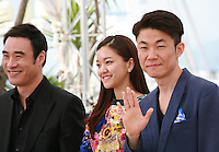 Bae Seong-woo, Ko A-sung, Hong Won-Chan at the Office film photo call at the 68th Cannes Film Festival Tuesday May 19th 2015, Cannes, France.