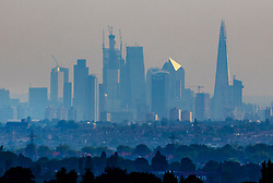 © Licensed to London News Pictures. 27/07/2018. London, UK. The City of London skyline is hazy as temperatures remain high, with thunder and lightning predicted later in parts of the UK. Photo credit: Peter Macdiarmid/LNP