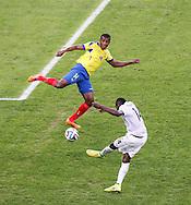 Blaise Matuidi of France (r) shoots past Oswaldo Minda of Ecuador during the 2014 FIFA World Cup Group E match at Maracana Stadium, Rio de Janeiro<br /> Picture by Andrew Tobin/Focus Images Ltd +44 7710 761829<br /> 25/06/2014