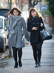©  London News Pictures. File picture dated 26/11/2013. London, UK. Italian Sisters Elisabetta 'Lisa' (left) and Francesca (right, with handbag) Grillo, who are the former personal assistants to Charles Saatchi and Nigella  Lawson, arriving at Isleworth Crown Court in London. The pair, who face fraud charges, are accused of misappropriating funds while working for Saatchi and Lawson. Photo credit : Ben Cawthra/LNP