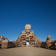'Reflection' wood face and hands installation at AfrikaBurn 2014, Tankwa Karoo desert, South Africa