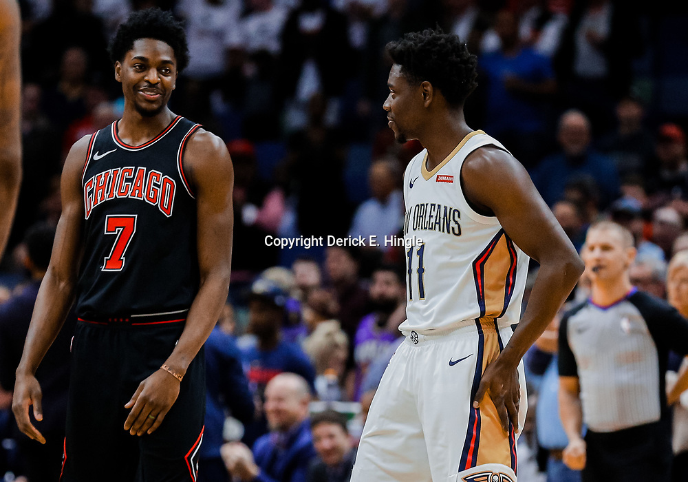 Jan 22, 2018; New Orleans, LA, USA; Chicago Bulls guard Justin Holiday (7) talks with his brother New Orleans Pelicans guard Jrue Holiday (11) before tip off at  the Smoothie King Center. Mandatory Credit: Derick E. Hingle-USA TODAY Sports