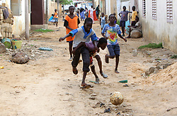 DAKAR, Sept. 5, 2011  Senegalese children play soccer at a village near Dakar, capital of Senegal, on Aug. 23, 2011. .In Senegal, located on the western tip of the African continent, there must be soccer enthusiasts if there is an open area, no matter dawn or dusk, sunny or rainy. Senegalese boys begin to play soccer since five or six years old in their childhood. Although most of them have no opportunity to wear a pair of professional plimsoll or to play soccer on a professional field, their love for soccer can not be stopped by anything. .Senegal started amateur soccer league matches from 1960, and there was no professional league match until 2009. However, based on the people's enthusiasm for soccer, Senegal's national soccer team has entered the final eight of the World Cup 2002 and has won the champion of Africa Cup of Nations. .A great number of Senegalese soccer talents have emerged in Senegalese history, among whom there are also some big stars who play in professional leagues overseas. The former Arsenal captain Patrick Vieira was born in Dakar. Manchester United striker El Hadji Diouf is also Senegalese. .Senegalese soccer stars fulfilled their achievements and have become the heroes in local children's eyes. Palmer,  once a soccer player in professional leagues of Saudi Arabia, works as a soccer coach now. In Palmer's mind, it is true that some boys dream to become professional soccer players to change their own impoverished destiny. However, soccer's popularity in Senegal is more related with the love for soccer from the bottom of people's heart. Playing soccer does not need costly outfit and no matter you are rich or poor, all the players in the soccer field are equal with each other and could harvest endless happiness from the sport. (Credit Image: © Xinhua via ZUMA Wire)
