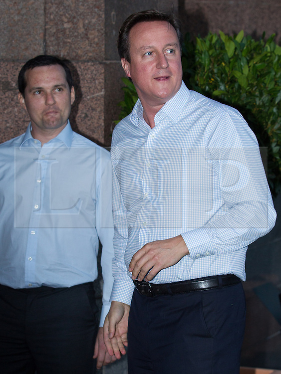 © Licensed to London News Pictures . 28/09/2013 . Manchester , UK . The British Prime Minister , DAVID CAMERON , arrives at the Midland Hotel in Manchester this evening (28th September 2013) ahead of the Conservative Party annual conference in Manchester , tomorrow (Saturday 29th September 2013) . Photo credit : Joel Goodman/LNP