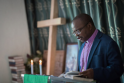 30 October 2019, Monrovia, Liberia: Bishop Dr Jensen Seyenkulo leads morning prayer at the Lutheran Compound in Monrovia.