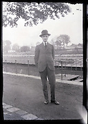 young adult man posing by river edge 1900s