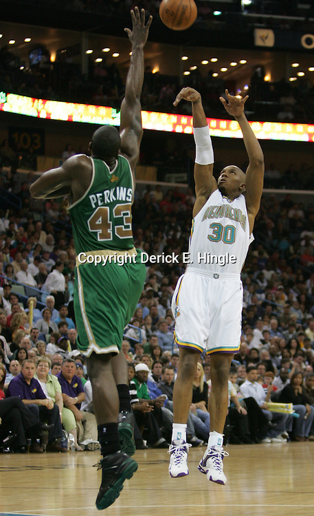 New Orleans Hornets forward David West #30 shootsover Boston Celtics center Kendrick Perkins  in the third quarter of their NBA game on March 22, 2008 at the New Orleans Arena in New Orleans, Louisiana. The New Orleans Hornets defeated the Boston Celtics 113-106.