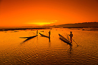 Legrowing fishermen on Inle Lake at sunset, Inle Lake, Shan State, Myanmar (Burma)