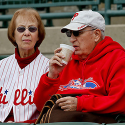 Mar 3, 2013; Sarasota, FL, USA; A Philadelphia Phillies fan warms up with a cup of coffee as the temperature  dipped into the 40's before a spring training game against the Baltimore Orioles at Ed Smith Stadium. Mandatory Credit: Derick E. Hingle-USA TODAY Sports