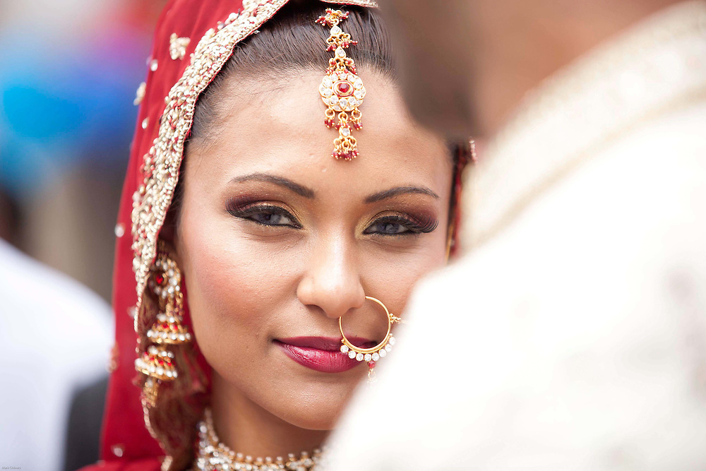 A model enacts a traditional Punjabi wedding during the street party to celebrate the Royal wedding. Outside the former home to Kate Middleton's Grandmother, the local community came out in their thousands to celebrate in Punjabi style on Clarence Street, Southall.