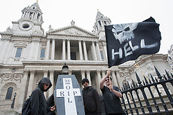© licensed to London News Pictures. London, UK 22/05/2012. Occupy London protesters posing with a mock coffin prepared for Shell and a flag with Shell's logo drawn as a skull, outside St Paul's today (22/05/12). Photo credit: Tolga Akmen/LNP