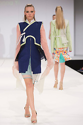 © Licensed to London News Pictures. 03/06/2013. London, England. Collection by graduate student Susanna Yi from UEL, University of East London. Graduate Fashion Week 2013 showcasing student collections takes place at Earl's Court II from 2 to 5 June 2013. Photo credit: Bettina Strenske/LNP