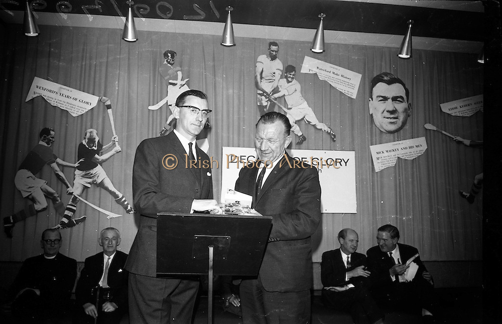 "17/05/1966<br /> 05/17/1966<br /> 17 May 1966<br /> Book reception for ""Decades of Glory: A Comprehensive History of the National Game"" by Raymond Smith.<br /> This reception was held in the offices of W.D. & H.O. Wills to honour the well known author and journalist, Raymond Smith. His book on the history of Hurling (""Decades of Glory"") has just been published with the assistance of Wills of Dublin and Cork and the Central Council of the G.A.A.<br /> Author, Raymond Smith (left) presents his book to  Seán Ó Síocháin, General Secretary of the G.A.A."