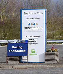 A view of a sign outside Huntingdon Racecourse saying 'Racing Abandoned'. An outbreak of equine flu has forced the cancellation of all British racing on Thursday.
