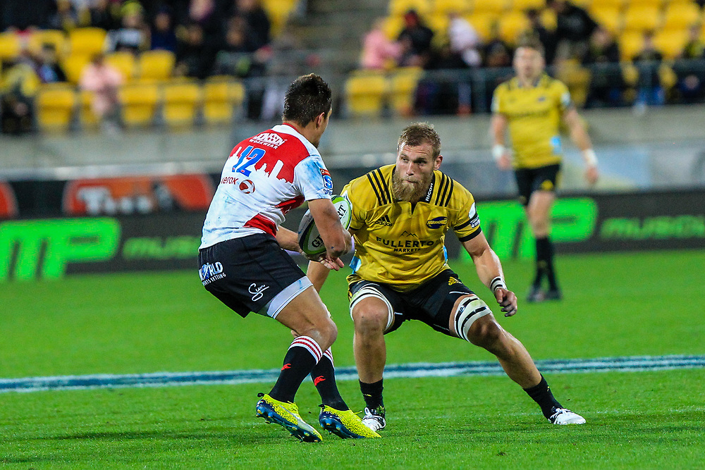 Harold Vorster attempts to pass Brad Shields (captain) during the Super rugby (Round 12) match played between Hurricanes  v Lions, at Westpac Stadium, Wellington, New Zealand, on 5 May 2018.  Hurricanes won 28-19.