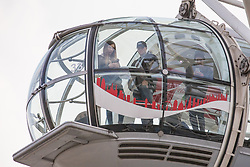 © Licensed to London News Pictures. 22/03/2017. London, UK. Tourists wait in a pod on the London Eye ferris wheel after it was stopped following reports of a terrorist incident in nearby Westminster. Photo credit: Rob Pinney/LNP