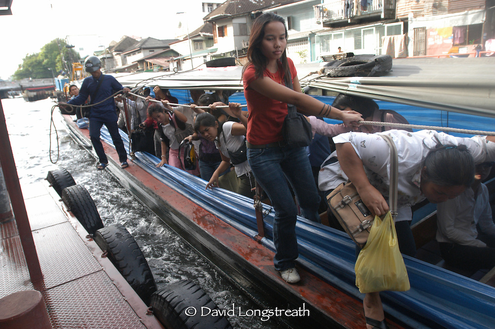 Bangkok residents as they use the canal boat system in downtown