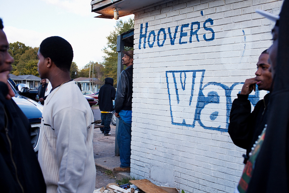 """Men loiter around Hoover's Convenience Store following the funeral of Demetrius """"Butta"""" Anderson, 18, in the Baptist Town neighborhood of Greenwood, Mississippi on Friday, November 5, 2010."""