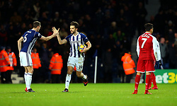 Jay Rodriguez of West Bromwich Albion celebrates with Jonny Evans of West Bromwich Albion after scoring a goal to make it 1-1 while Alexis Sanchez of Arsenal stands dejected - Mandatory by-line: Robbie Stephenson/JMP - 31/12/2017 - FOOTBALL - The Hawthorns - West Bromwich, England - West Bromwich Albion v Arsenal - Premier League
