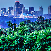 View of Kansas City Missouri skyline at dusk from the Rosedale Memorial Arch in Kansas City, Kansas.