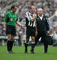 Photo. Andrew Unwin.<br /> Newcastle United v Wolverhampton Wanderers, FA Barclaycard Premier League, St James Park, Newcastle upon Tyne 09/05/2004.<br /> Newcastle's Alan Shearer (c) walks off the field to receive treatment after damaging his shoulder.