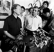 "1976 Democratic presidential nominee Jimmy Carter and his running mate Walter ""Fritz"" Mondale with wife Joan, speak to the press at the Plains, Georgia railway depot. - To license this image, click on the shopping cart below -"