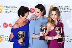 Fiona Shaw, Phoebe Waller-Bridge and Jodie Comer in the press room during the Virgin Media BAFTA TV awards, held at the Royal Festival Hall in London. Photo credit should read: Doug Peters/EMPICS