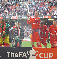 CARDIFF, WALES - SATURDAY, MAY 13th, 2006: Liverpool's Peter Crouch sprays champagne after beating West Ham United to win the FA Cup Final at the Millennium Stadium. (Pic by Jason Roberts/Propaganda)