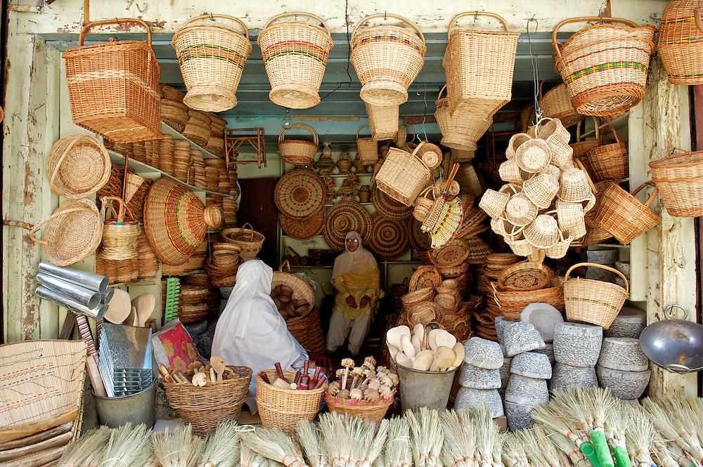 Woman seller of wicker baskets in Srinagar bazaar. Kashmir. India