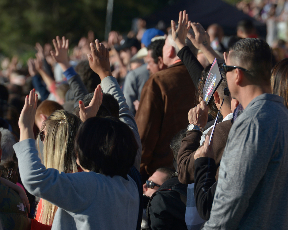 gbs041617d/ASEC -- People raise their hands in praise during a song at the Calvary Albuquerque's  Easter Sunrise Service: Against All Odds on Sunday, April 16, 2017. (Greg Sorber/Albuquerque Journal)