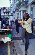 Dreadlocked toaster dancing in the street Notting Hill Carnival London 2003