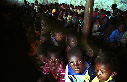 Children at an orphanage wait to eat at a feeding center in Huambo in the interior region of Angola.  Angola's brutal 26 year-civil war has displaced around two million people - about a sixth of the population - and 200 die each day according to United Nations estimates. .(Photo by Ami Vitale)