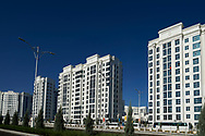 Ashgabat, Turkmenistan - 2017 September 21: A view of marble white apartment blocks in a street while 2017 Ashgabat 5th Asian Indoor & Martial Arts Games on September 21, 2017 in Ashgabat, Turkmenistan.<br /> <br /> Mandatory credit:<br /> Photo by © Adam Nurkiewicz<br /> <br /> Adam Nurkiewicz declares that he has no rights to the image of people at the photographs of his authorship.<br /> <br /> Picture also available in RAW (NEF) or TIFF format on special request.<br /> <br /> Any editorial, commercial or promotional use requires written permission from the author of image.