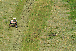 THEMENBILD - ein Landwirt mit Traktor und Maehwerk bei der Heuernte auf einem steilen Hang, aufgenommen am 11. August 2015, Maishofen, Österreich// a farmer with tractor mowing hay in a Field, Maishofen, Austria on 2015/08/11. EXPA Pictures © 2015, PhotoCredit: EXPA/ JFK