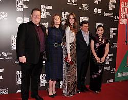 "Glasgow Film Festival 2018<br /> <br /> The World Premiere of ""THE PARTY'S JUST BEGINNING"" was attended by actor/director Karen Gillan<br /> <br /> Pictured: Karen Gillan (centre) with her backroom team<br /> <br /> Alex Todd | EEm"