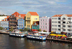 Willemstad, Curacao: Two ferries await passengers along Willemstad's famous and photogenic waterfront.