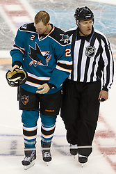 Jan 31, 2012; San Jose, CA, USA; San Jose Sharks defenseman Jim Vandermeer (2) is escorted to the penalty box by NHL linesman Pierre Champoux (67) after fighting Columbus Blue Jackets right wing Jared Boll (not pictured) during the third period at HP Pavilion. San Jose defeated Columbus 6-0. Mandatory Credit: Jason O. Watson-US PRESSWIRE