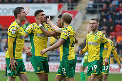 Norwich City's (second left) Ben Godfrey celebrates scoring his side's second goal of the game during the Sky Bet Championship match at the AESSEAL New York Stadium, Rotherham.