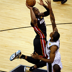 Jun 16, 2013; San Antonio, TX, USA; Miami Heat shooting guard Dwyane Wade (3) shoots against San Antonio Spurs small forward Kawhi Leonard (2) during the first quarter of game five in the 2013 NBA Finals at the AT&T Center. Mandatory Credit: Derick E. Hingle-USA TODAY Sports