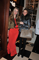 Left to right, sisters BRYONY DANIELS and SUZIE DANIELS at a party hosted by TLC to celebrate signing their 5000th member and Ralph Lauren to celebrate the opening of the first Ralph Lauren Rugby store in the UK at 43 King Street, Covent Garden, London on 30th November 2011.