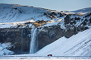 Spectacular waterfall Seljalandsfoss in South Iceland with glacial melting waters from Eyjafjahajokul icecap