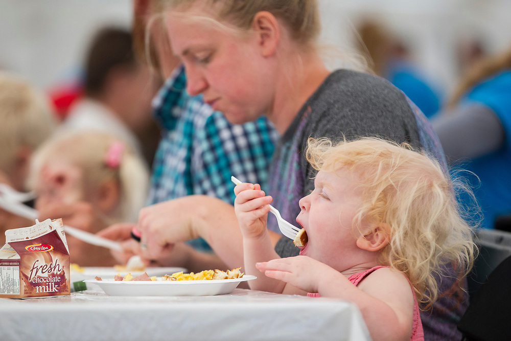 Juliet Kember (2) enjoys her breakfast during the Breakfast on the Farm event near Shedden, Ontario, Saturday, June 24, 2017.<br /> Farmers Forum/ Geoff Robins
